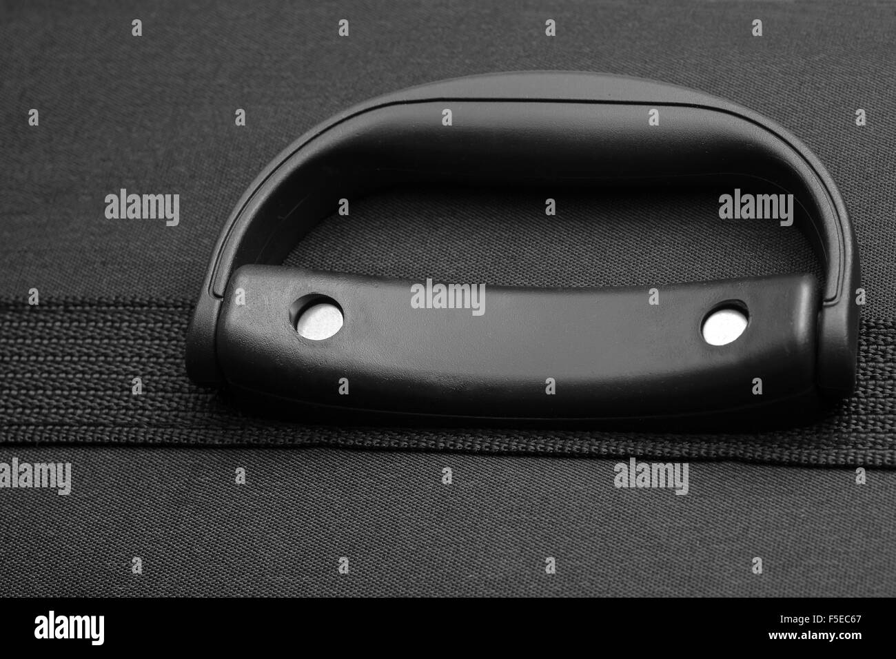black travel suitcase handle closeup - Stock Image