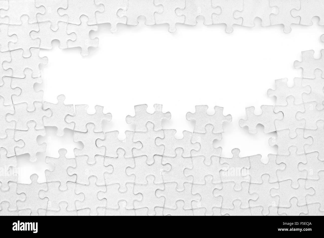 incomplete puzzle background on white - Stock Image