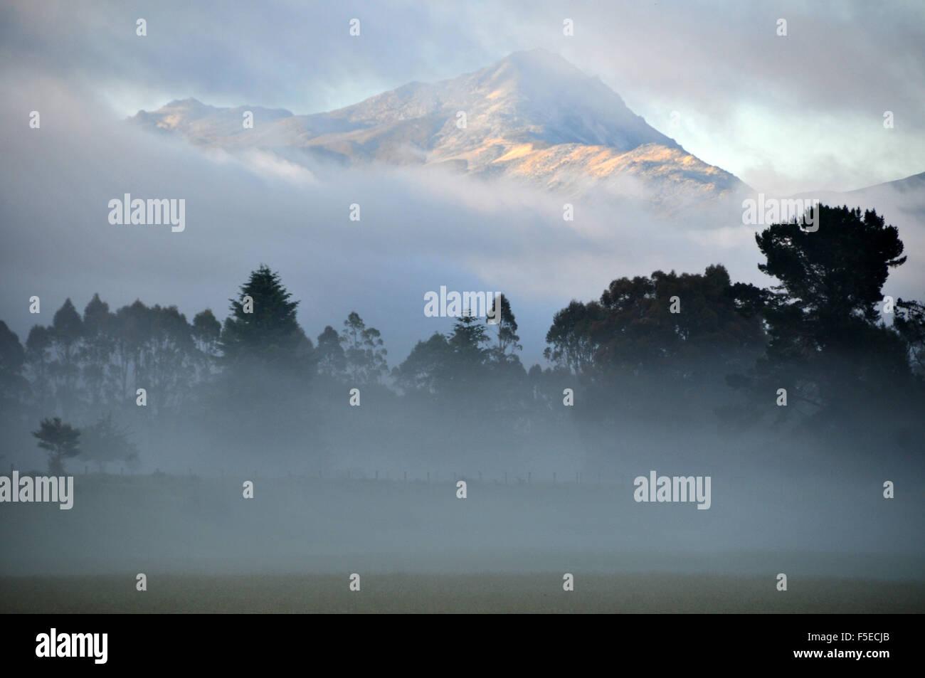 Misty mountain around Manapouri, Fiordland National park, Southland, South Island, New Zealand - Stock Image