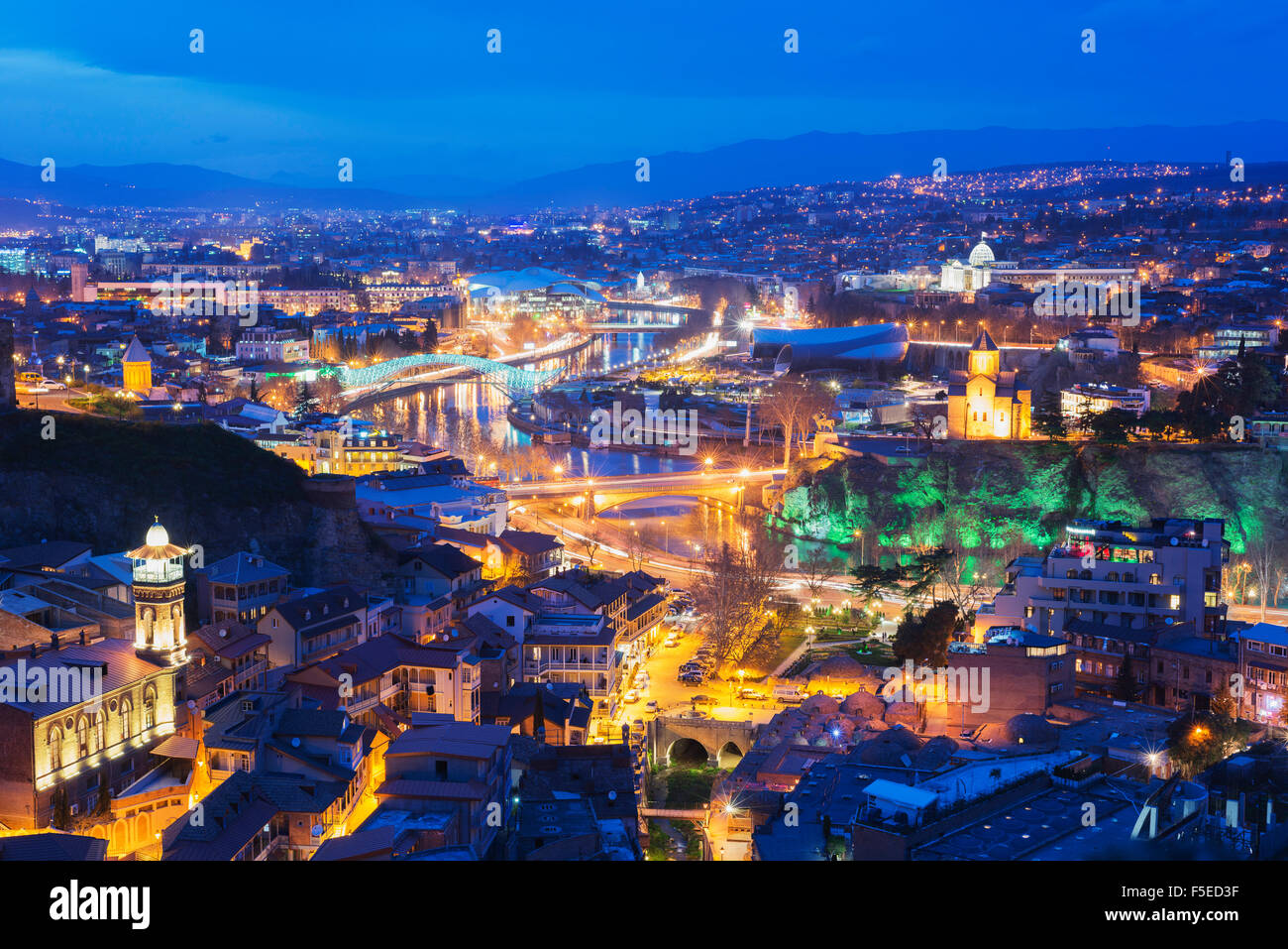 City view including Bridge of Peace and Public Service Hall House of Justice on Mtkvari River, Tbilisi, Georgia, - Stock Image
