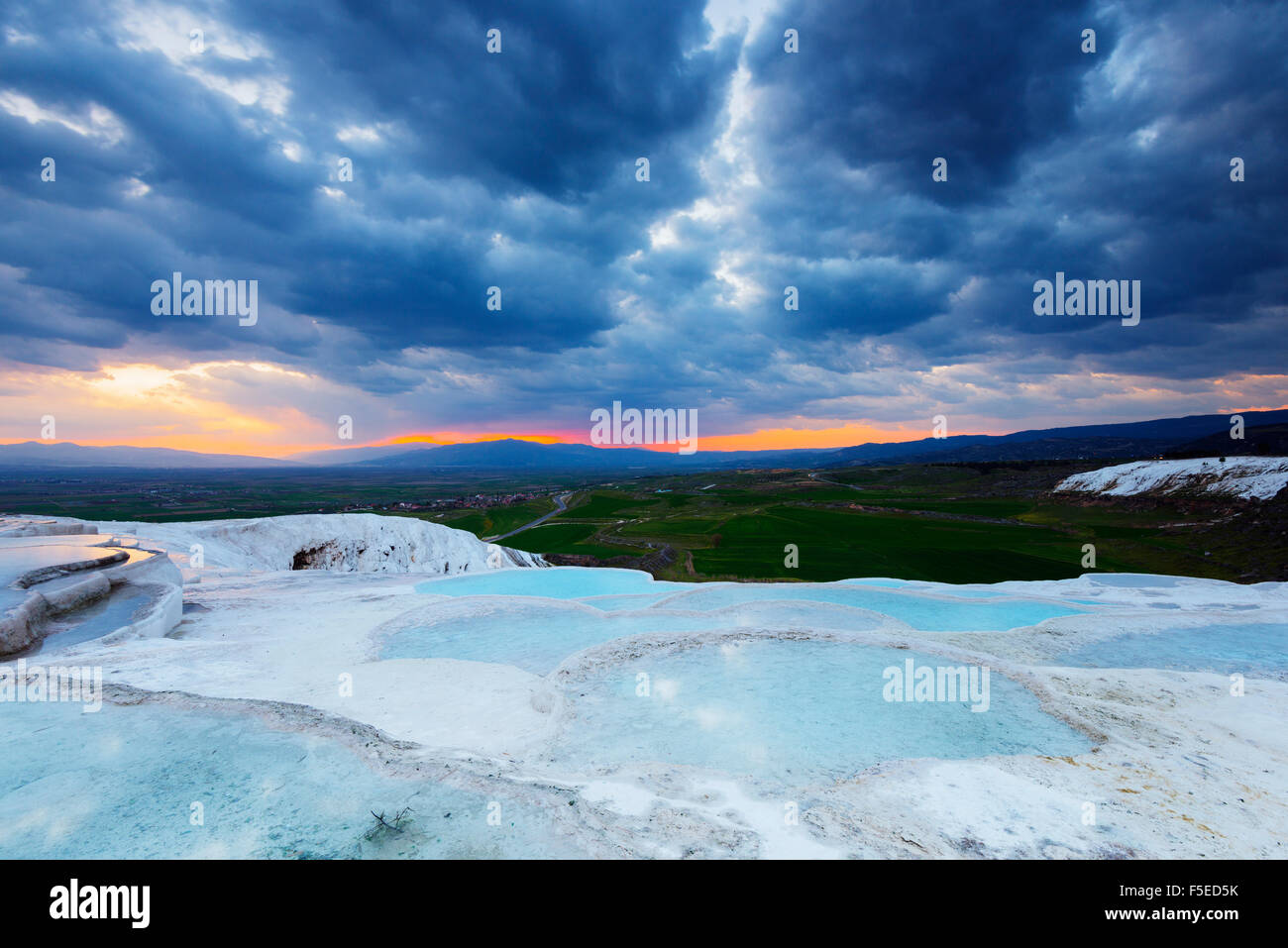 White travertine basins at sunset, Pamukkale, UNESCO World Heritage Site, Western Anatolia, Turkey, Asia Minor, - Stock Image