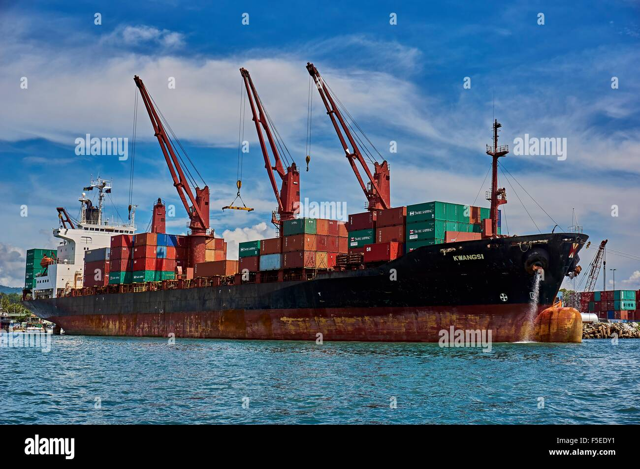 Container Ship Freighter at port of Honiara Solomon Islands - Stock Image