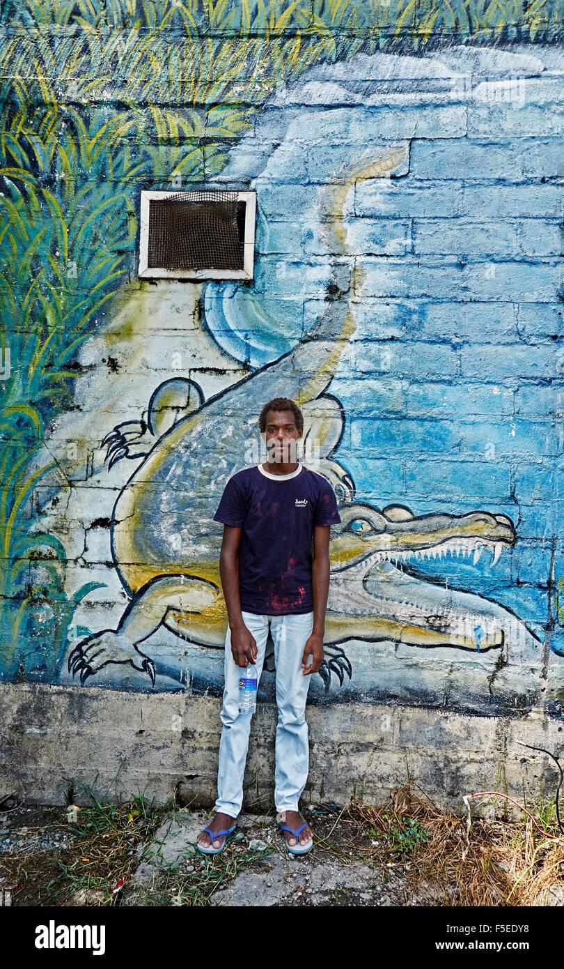 Youth in front of Crocodile Street Art of Honiara Solomon Islands - Stock Image