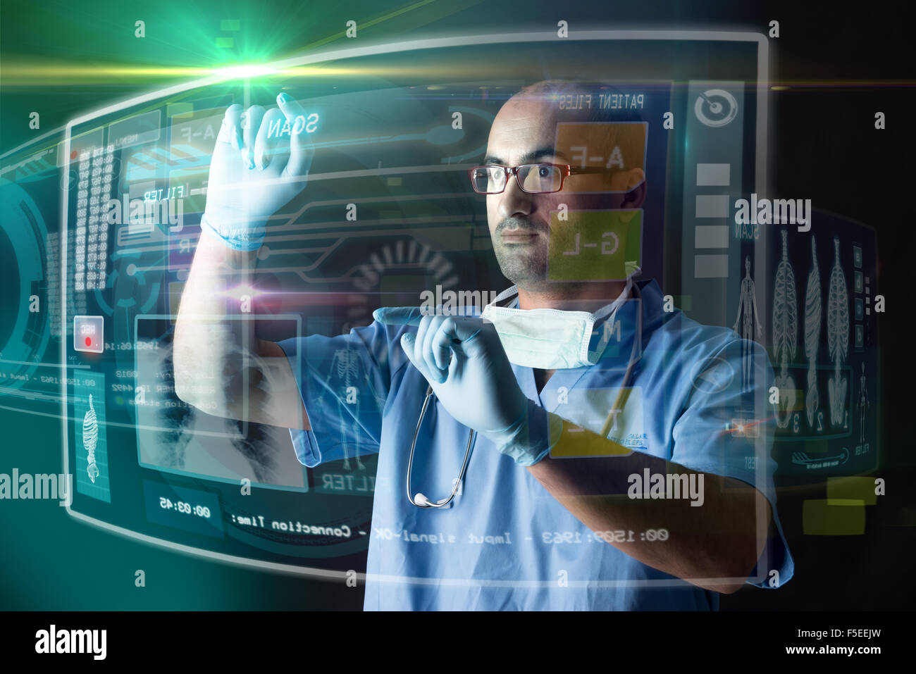 Doctor working with modern screens in a lab - Stock Image