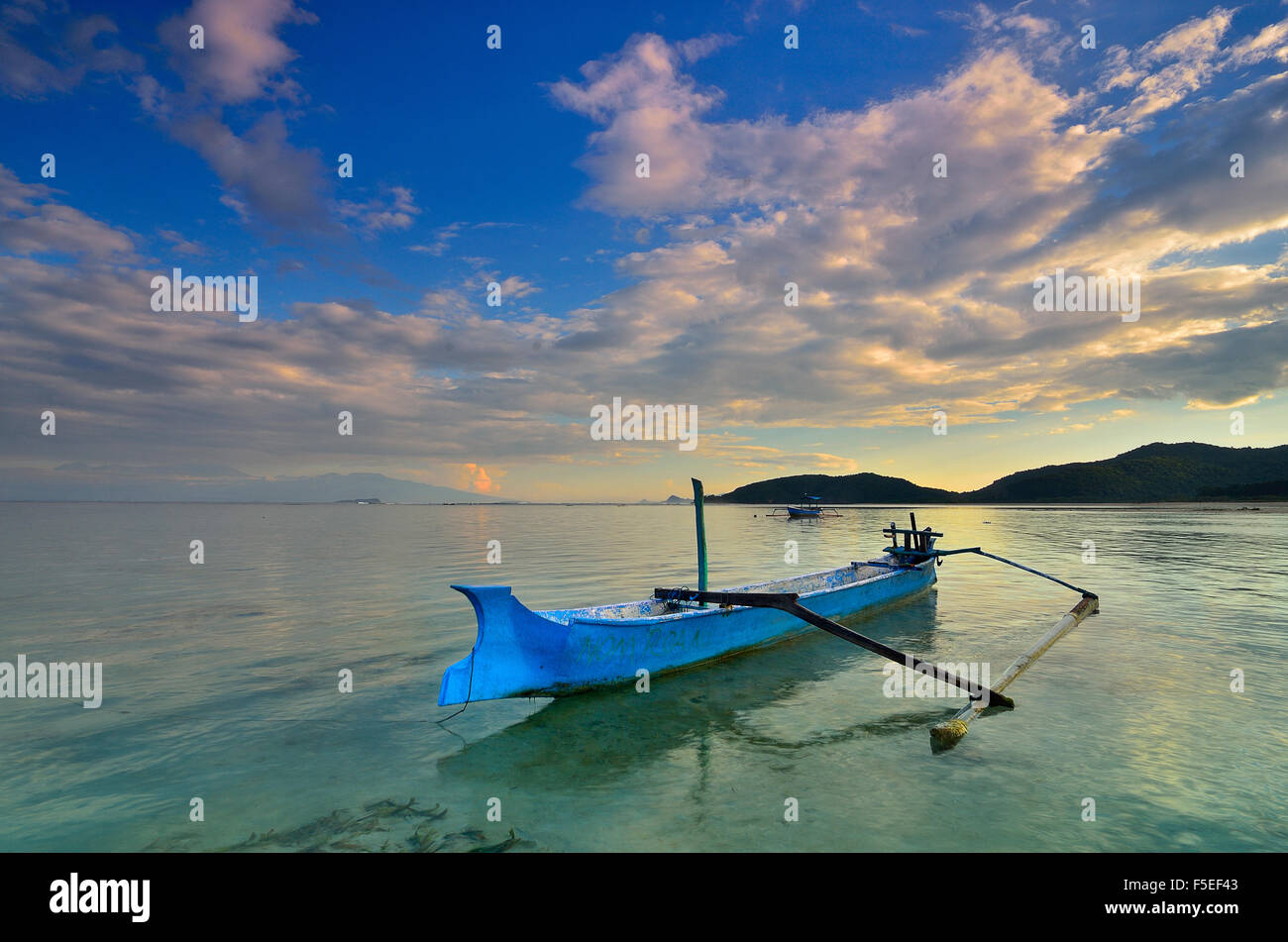 Boat anchored at Jelenga Beach, Sumbawa Island, Indonesia - Stock Image