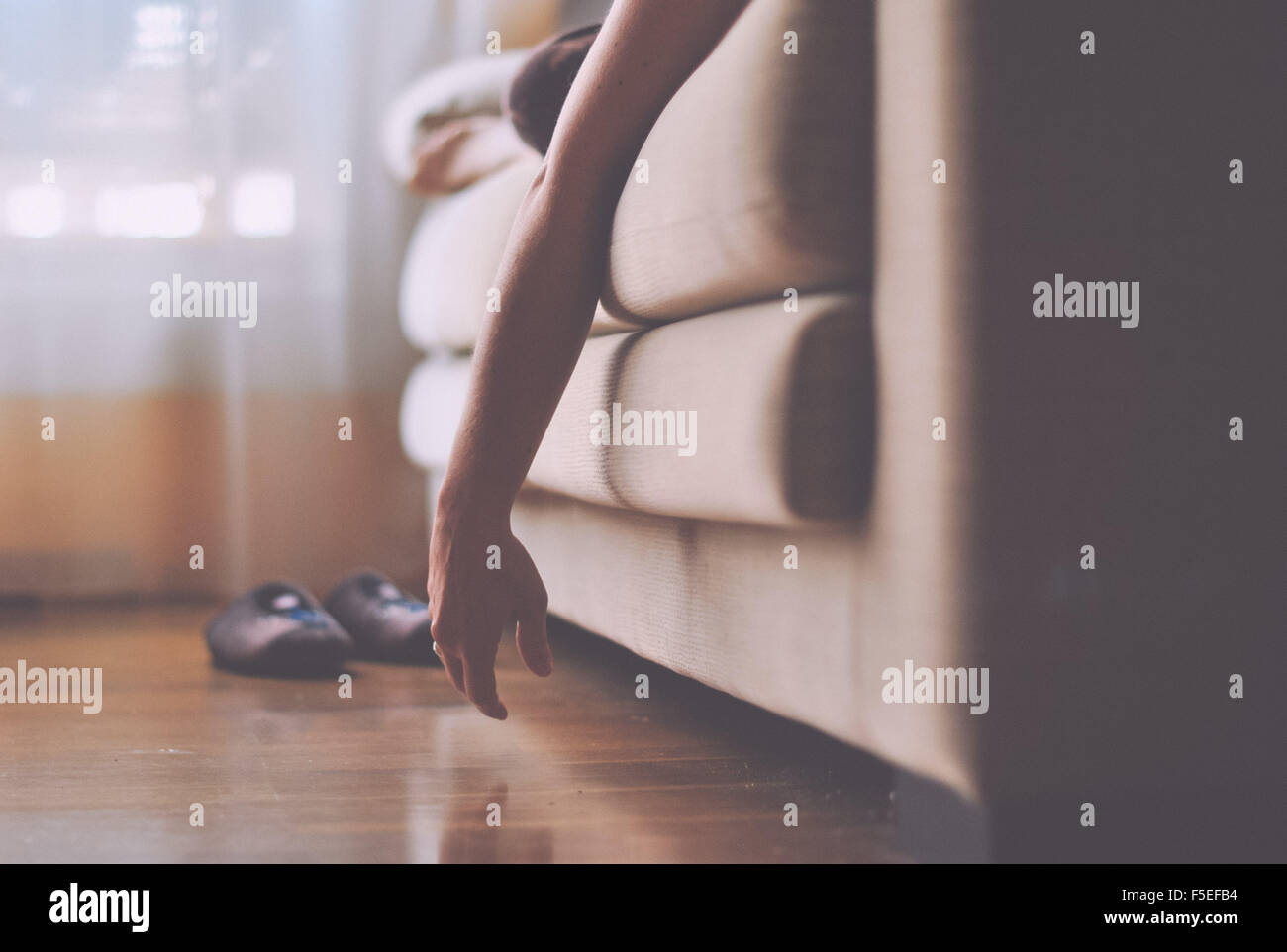 Woman lying on sofa relaxing - Stock Image