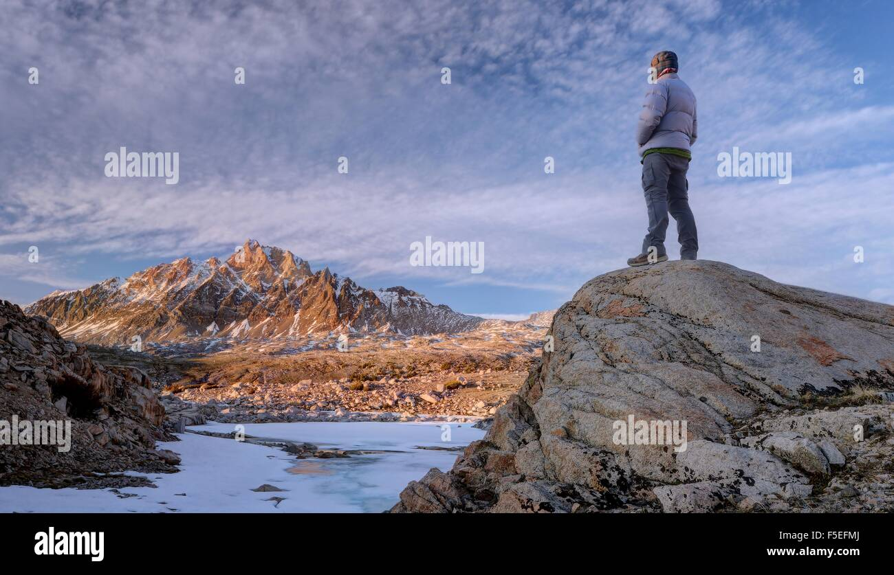 Man looking at mount humphreys, Sierra National Forest, California, USA - Stock Image