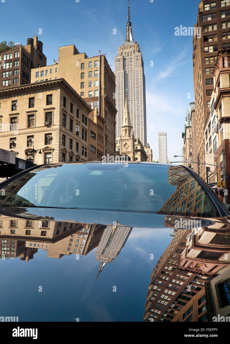 Reflection of empire state building on parked car, New York, America, USA - Stock Image