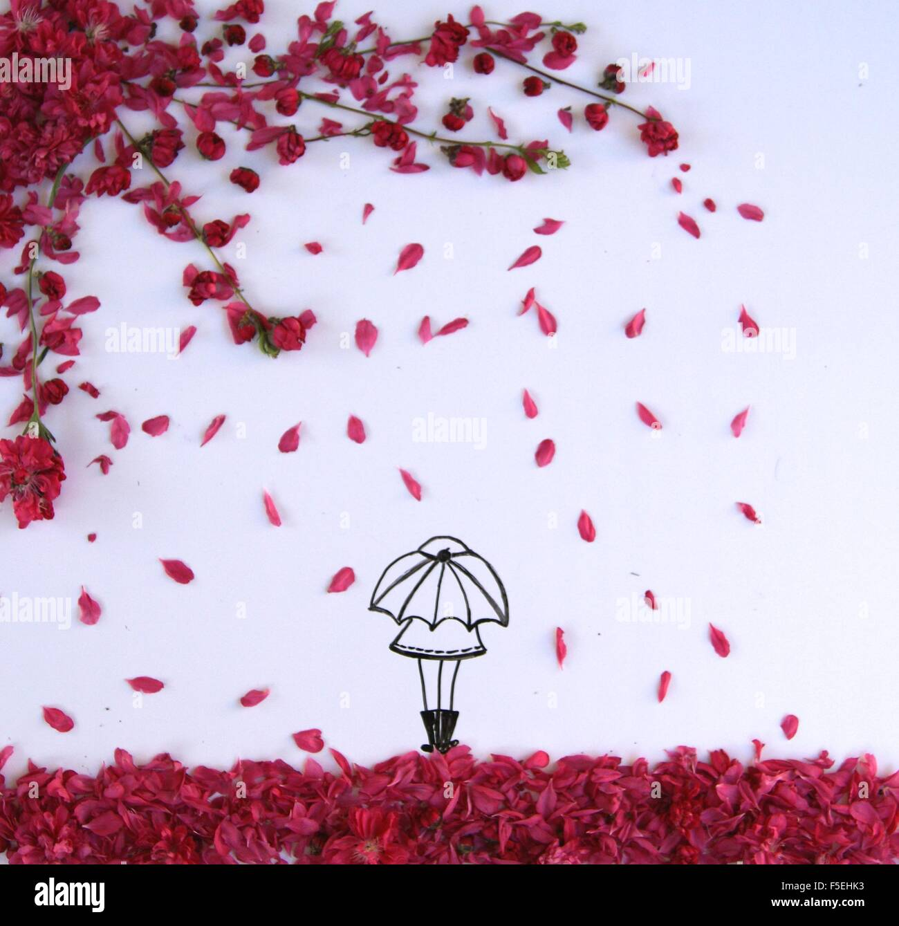 Conceptual drawing of a girl standing under an umbrella during spring blossom shower - Stock Image