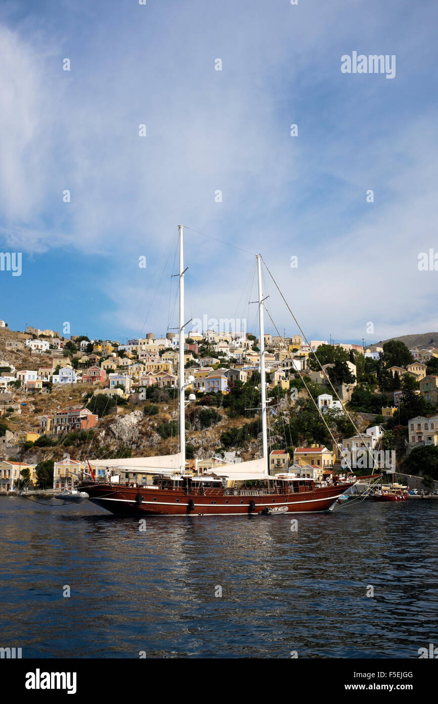 A Gulet anchored in Yialos bay on the Greek island of Symi. Stock Photo