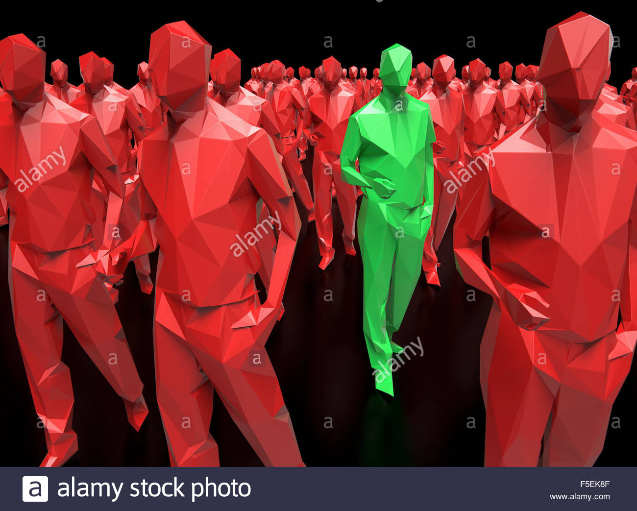 Green plastic man standing out from the crowd of identical red men - Stock Image