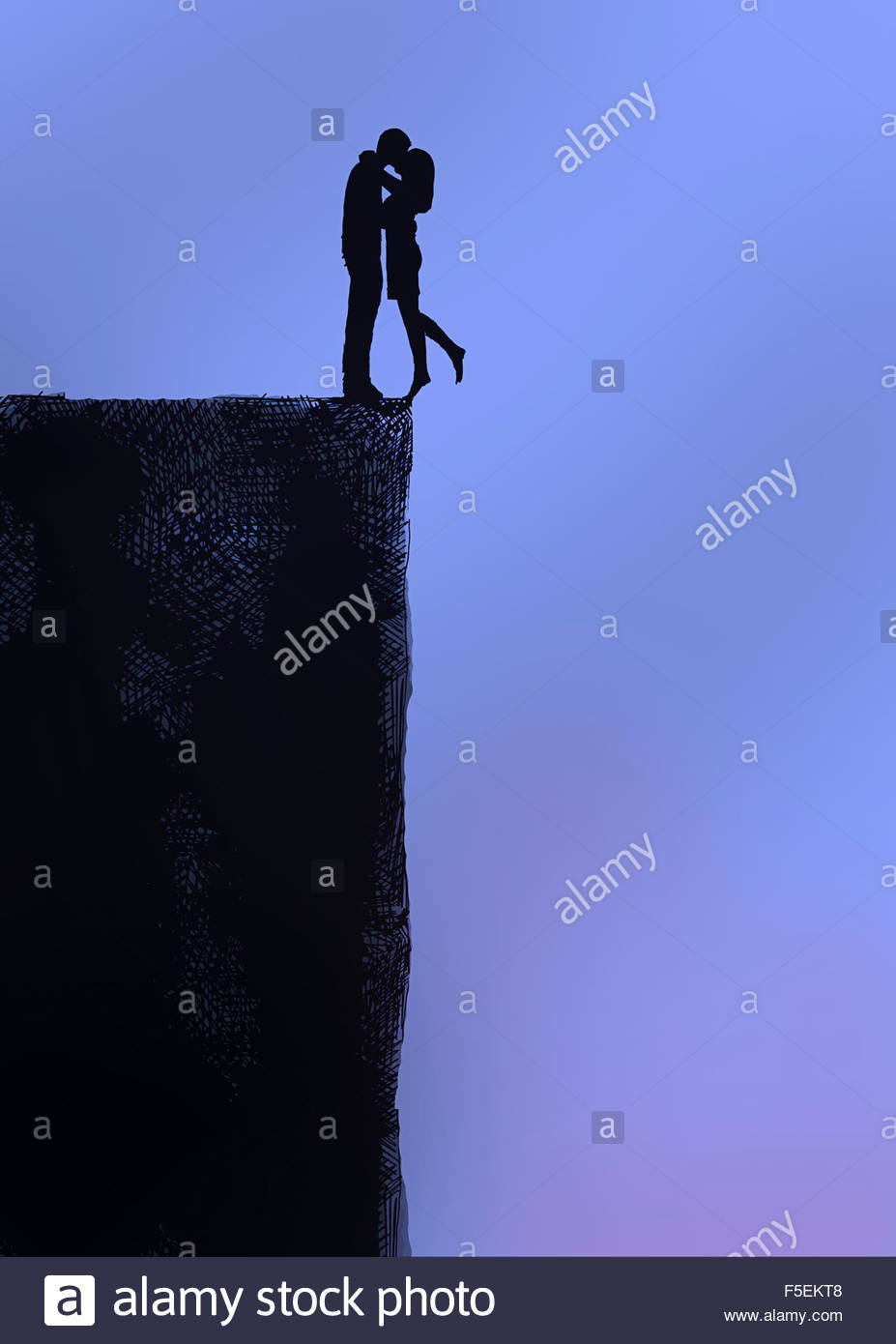 Couple kissing at the edge of a cliff - Stock Image