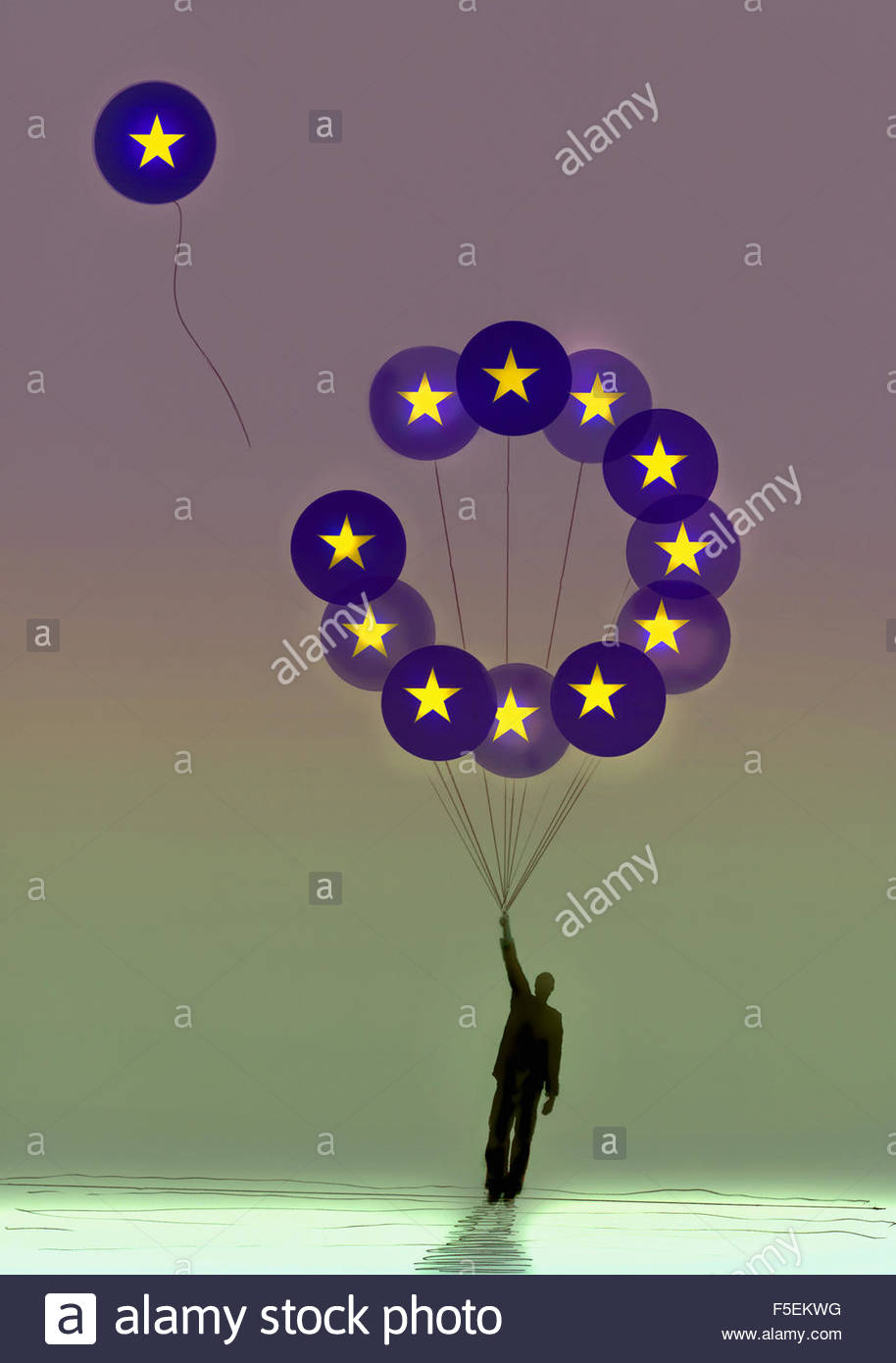 Businessman holding European Union flag symbol balloons with one leaving - Stock Image