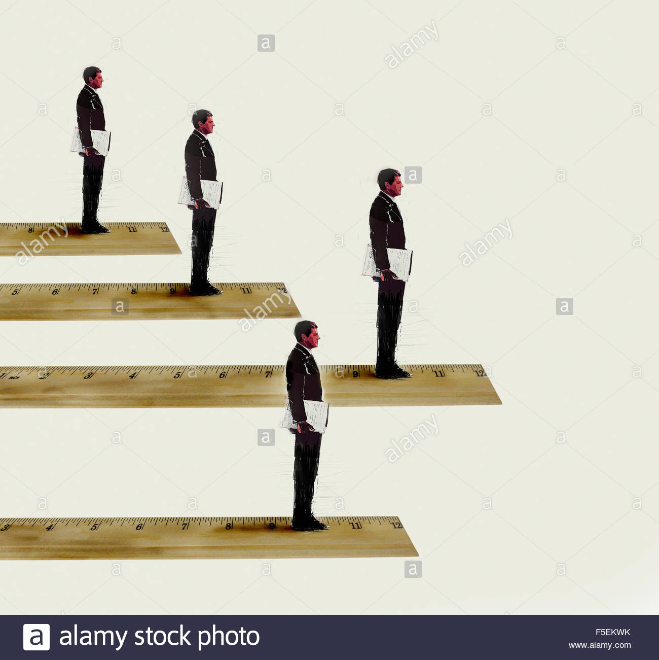 Businessmen standing in rank order on rulers - Stock Image
