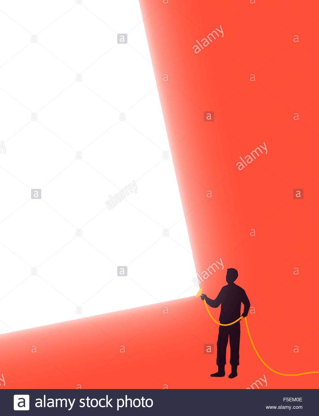 Man shining bright beam of light - Stock Image