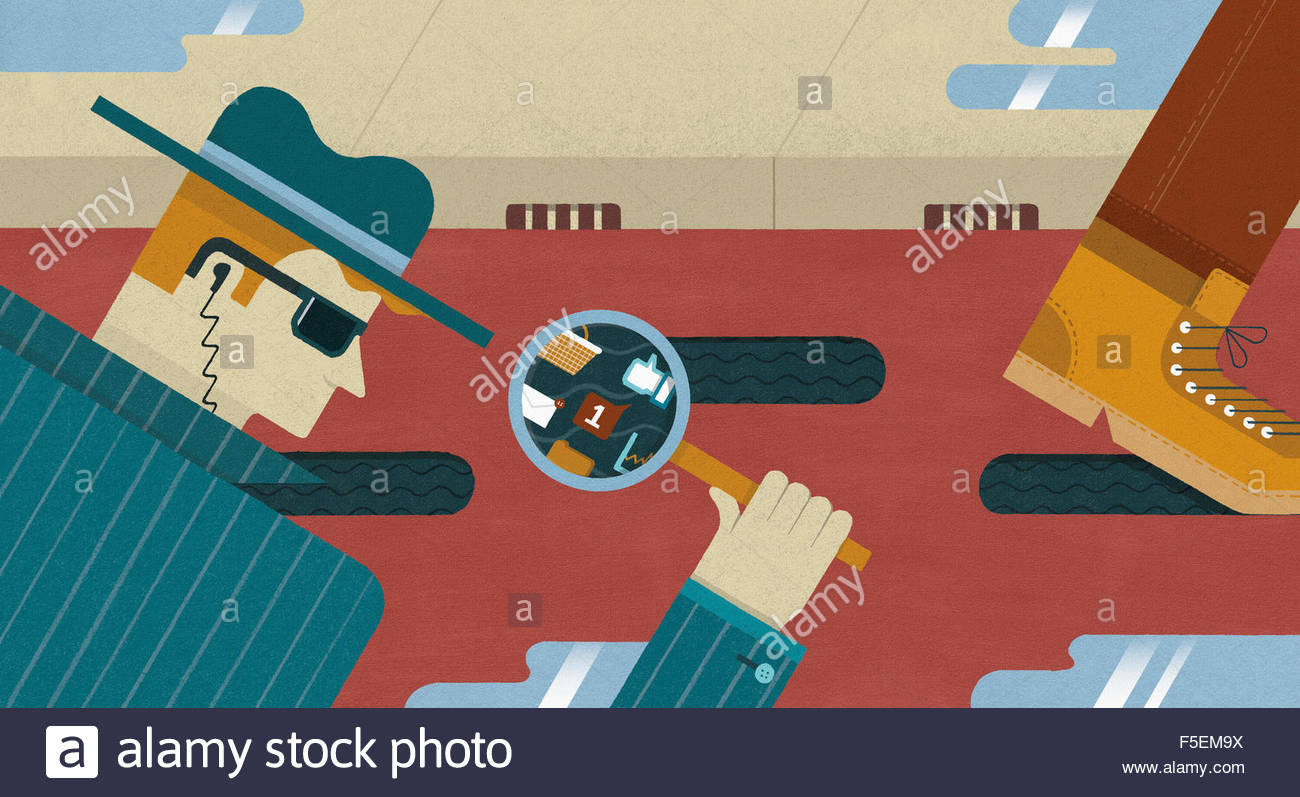 Spy looking through magnifying glass at footprints and accessing computer data - Stock Image