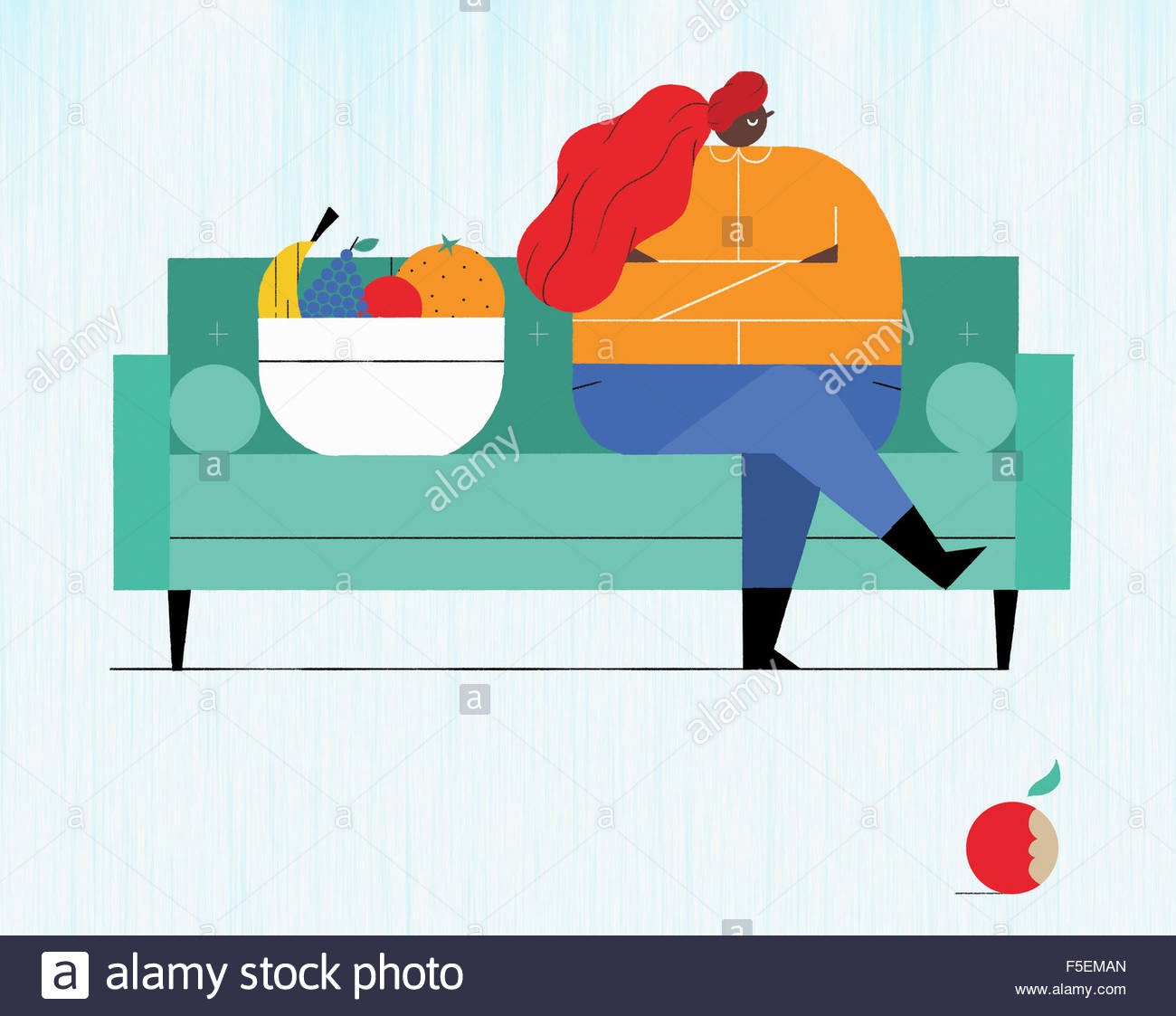 Displeased overweight woman sitting on sofa rejecting fresh fruit - Stock Image