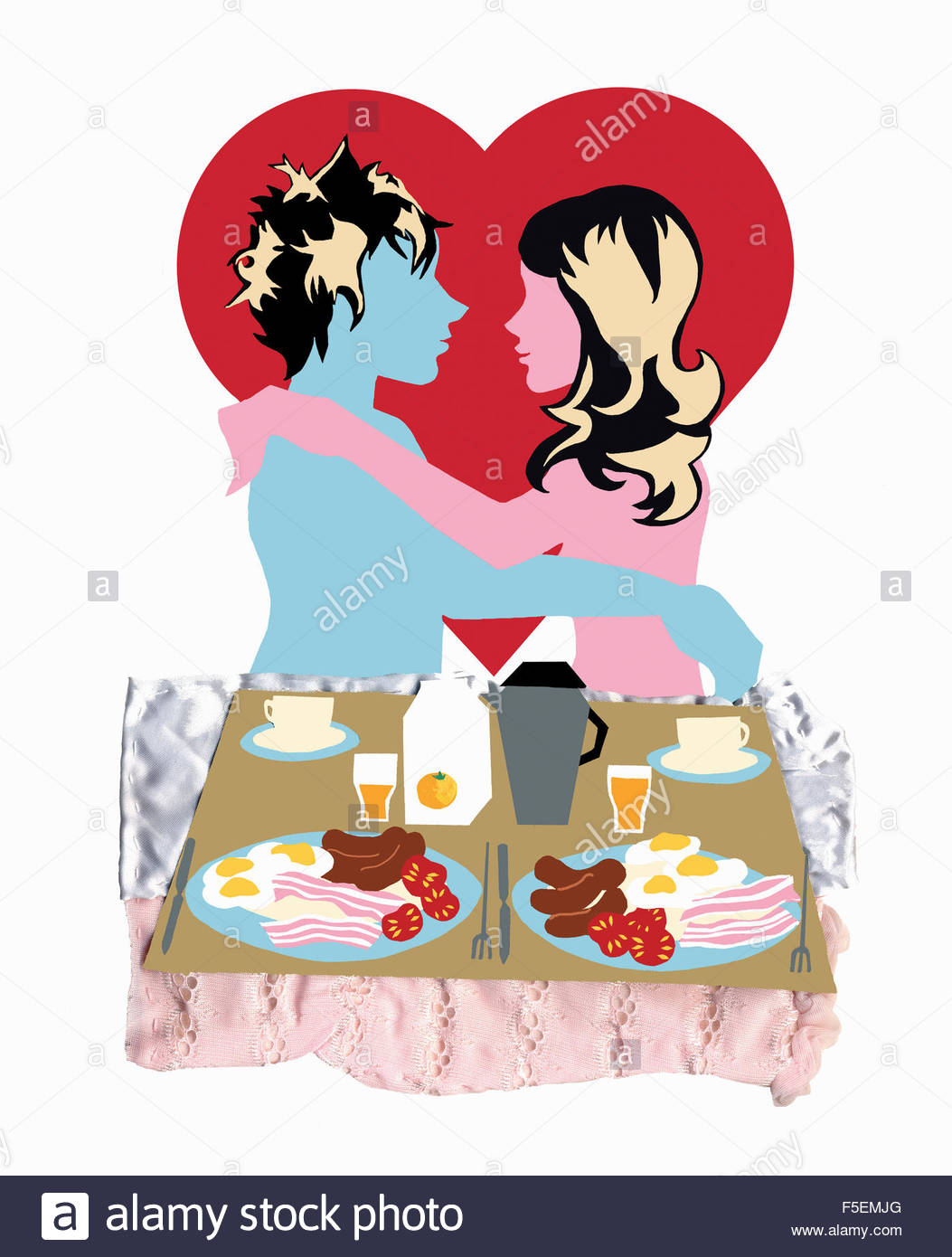Young couple embracing with breakfast in bed - Stock Image