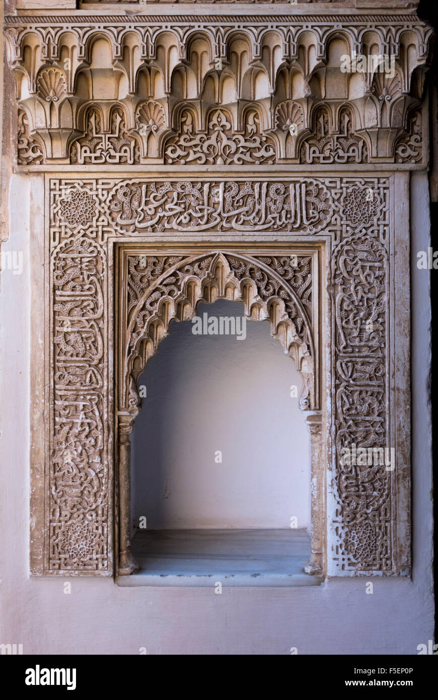 Wall niche with ornate carved arch in courtyard of Alhambra palace, Granada, Spain Stock Photo