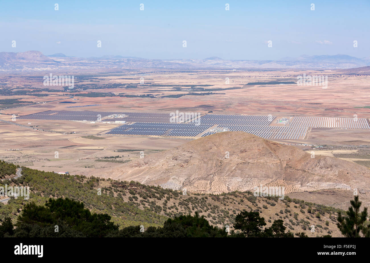 Aerial view of solar panels in a large solar farm array in the countryside in Southern Spain - Stock Image