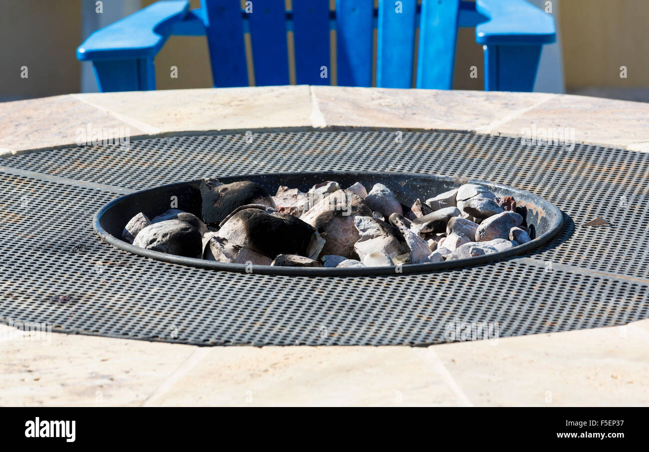 Gas or propane powered charcoal firepit with white hot coals - Stock Image