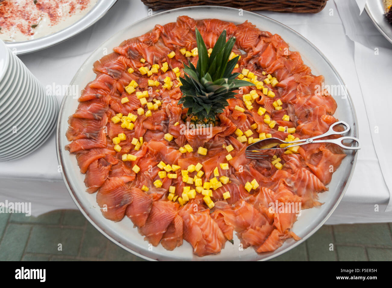 Ananas Buffet party outdoors, tasty appetizer, plate of salmon with ananas stock
