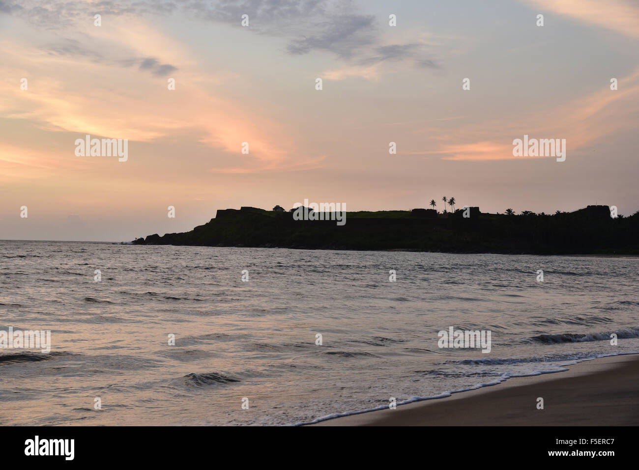Sunset over ocean and beach in Kerala India.Bekal fort beach Kasargode Beach,cloud,flat,horizon,india,indian,kerala,ocean Stock Photo