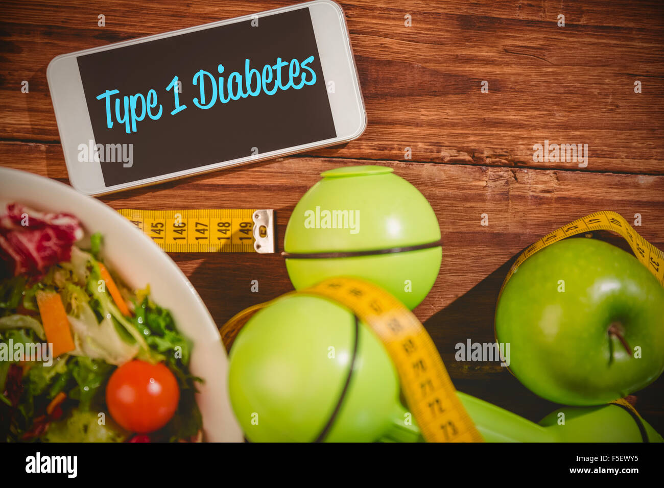 Type 1 diabetes against phone on healthy persons desk - Stock Image
