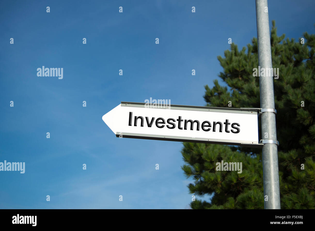 Signpost with 'Investments' direction sign. - Stock Image
