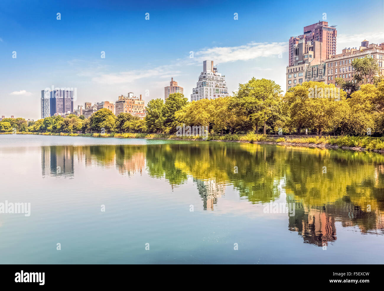 Central Park reflected in lake, New York City, USA. - Stock Image