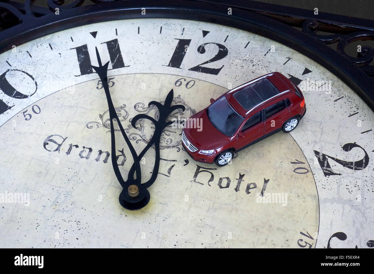 Illustration - A Volkswagen car model 'VW Tiguan' on a clock where it is five to twelve o'clock . The - Stock Image
