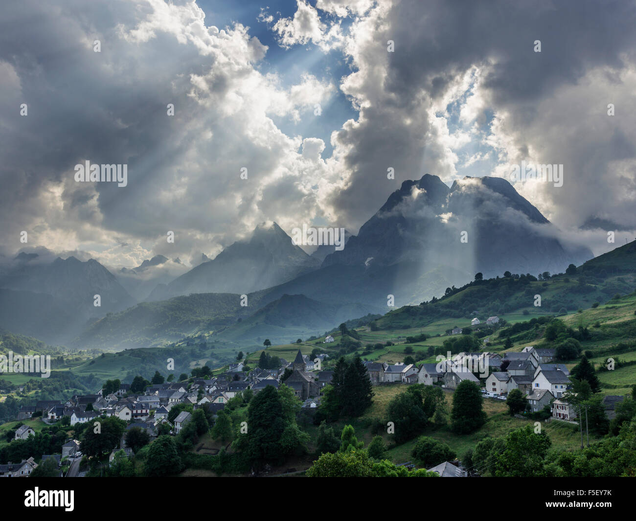 Evening light above village, high Pyrenees behind, Lescun, Aquitaine, France - Stock Image
