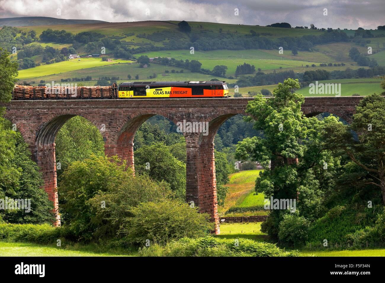 Colas Rail Freight train on Dry Beck Viaduct, Armathwaite, Eden Valley, Cumbria, England, UK. - Stock Image