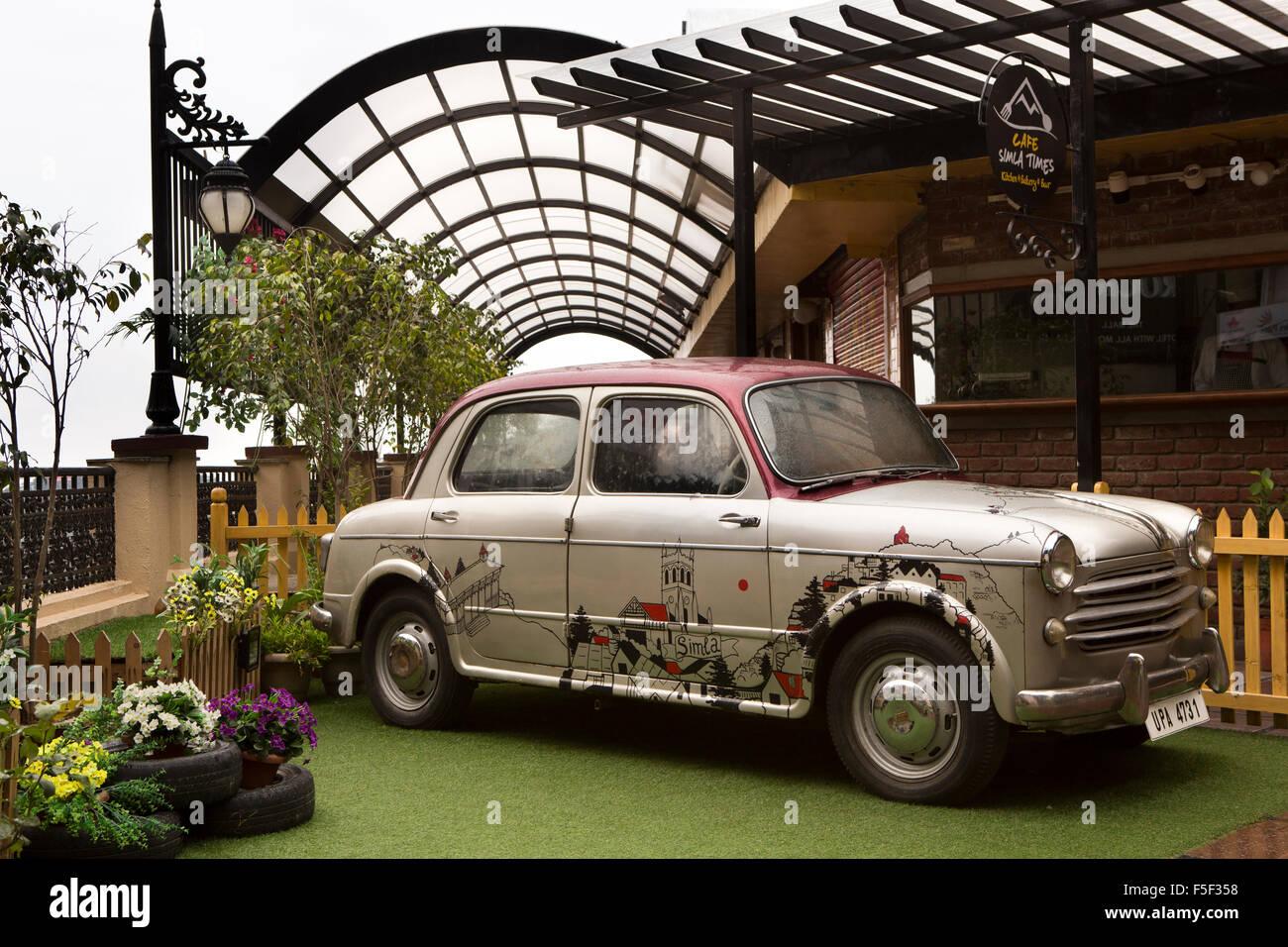 India, Himachal Pradesh, Shimla (Simla), Mall Road, vintage Hindustan Ambassador car outside Shimla Times Cafe - Stock Image