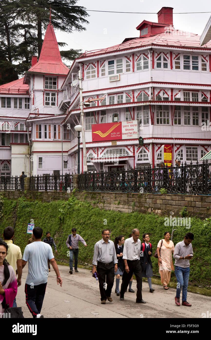 India, Himachal Pradesh, Shimla (Simla), Mall Road, people on ridge by historic colonial Main Post Office - Stock Image