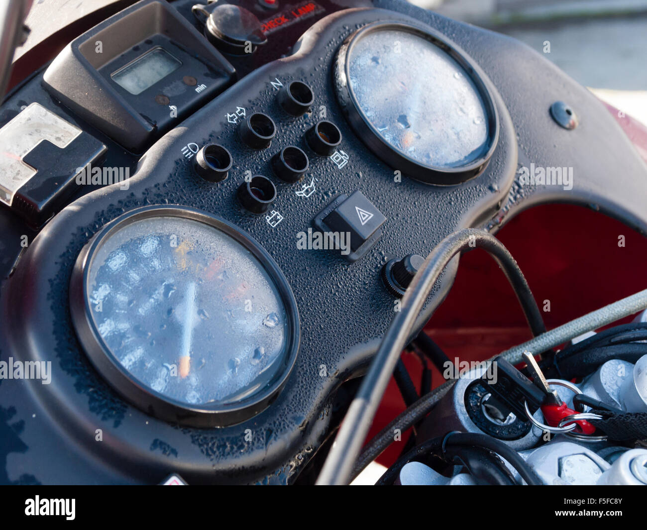 Condensed water on the instrument panel of a classic Moto Guzzi Quota motorbike parked outside in the cold - Stock Image