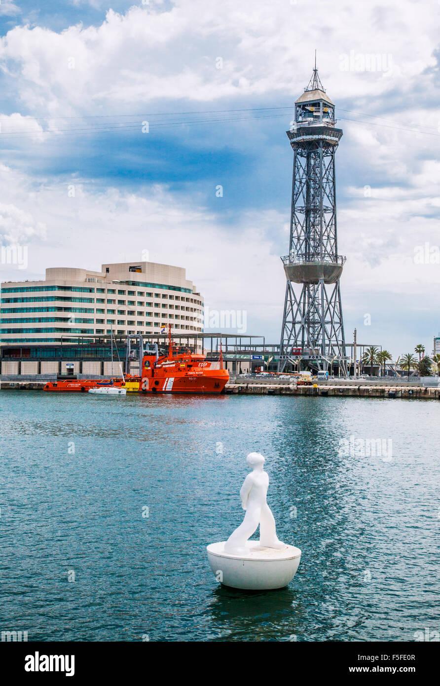 Spain, Catalonia, Barcelona, Port Vell, Rambla del Mar, floating statue stargazer by sculptor Robert Llimos - Stock Image