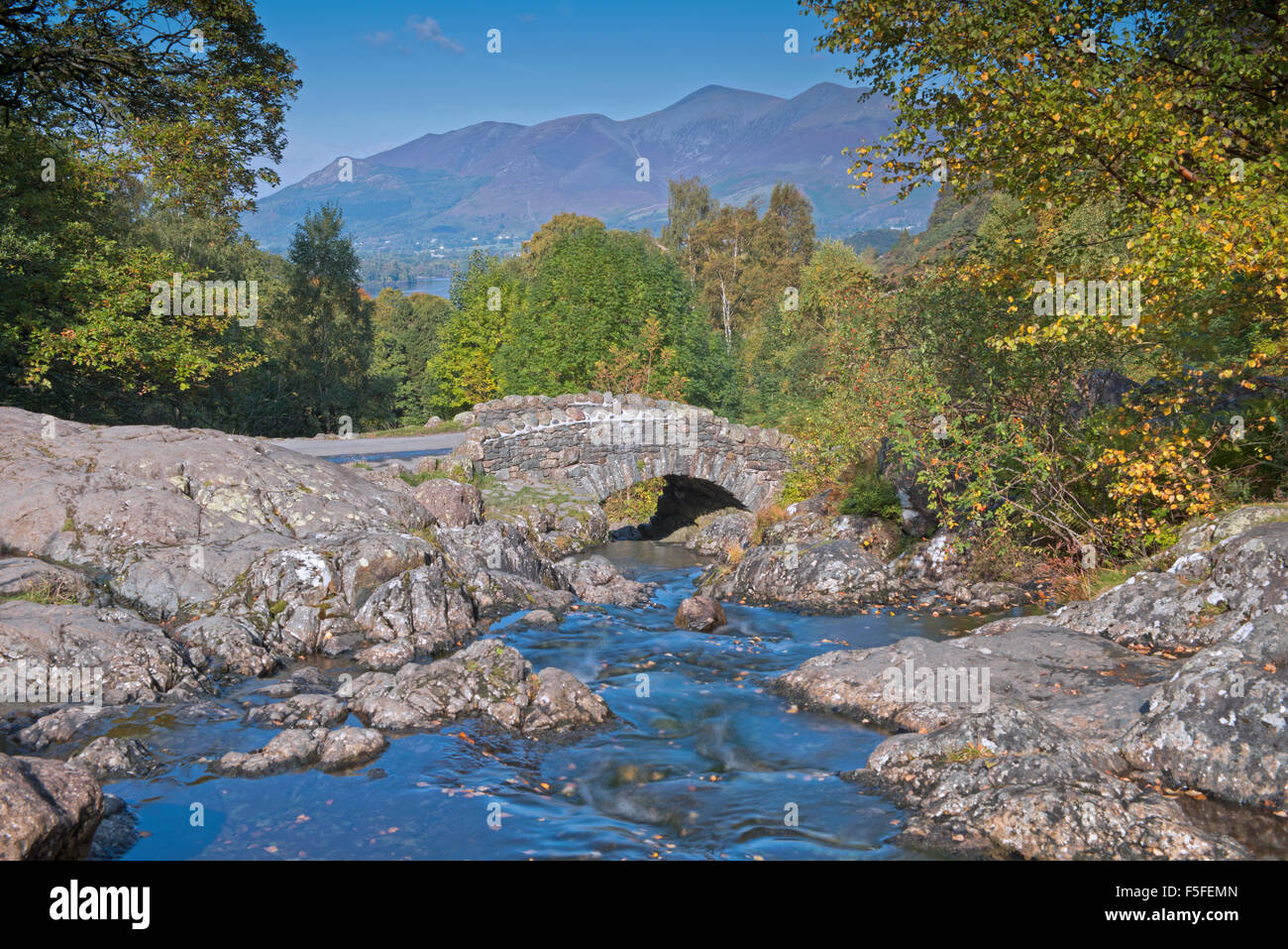 Ashness Bridge in autumn  and views across Catbells and Maiden Moor, Lake District, Cumbria, England, Uk, Gb. - Stock Image