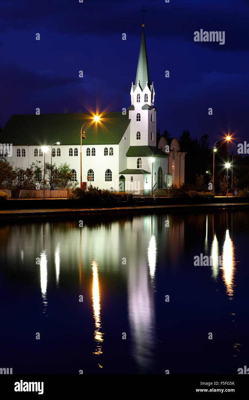 Frikirkjan Church reflected on Tjorning Pond, Reykjavik, Iceland - Stock Image