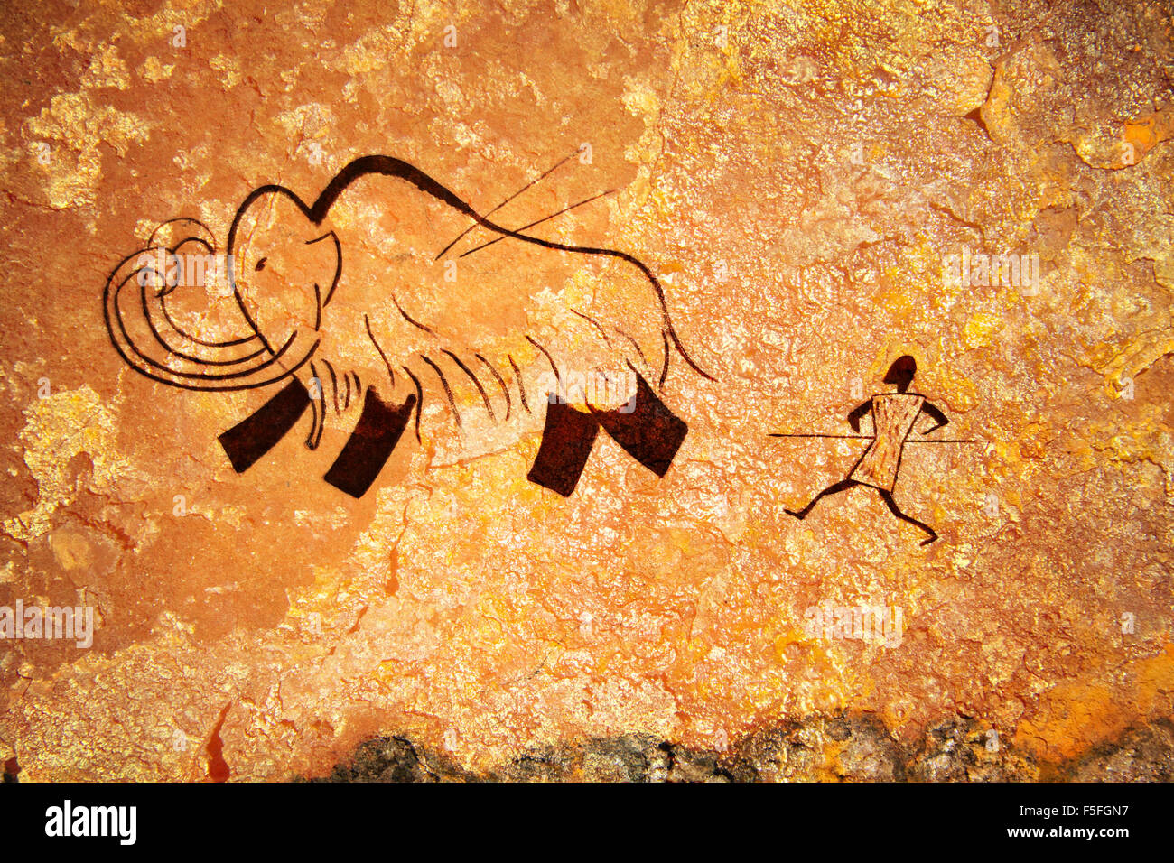 Cave painting of primitive hunt - Stock Image