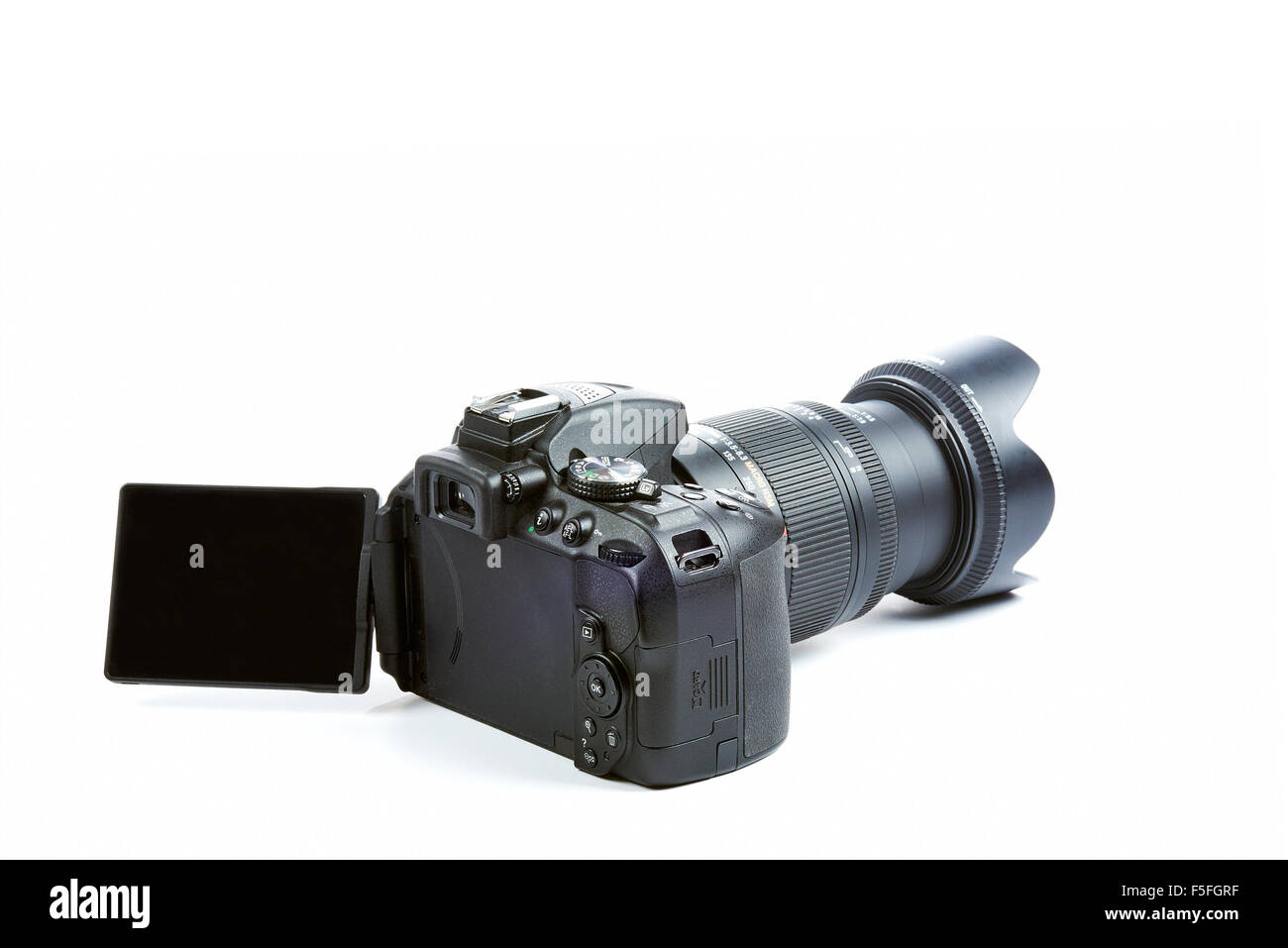 Nikon D5300 DSLR Camera with Zoom Sigma 18-250 mm OS HSM Macro Lens isolated on white background - Stock Image