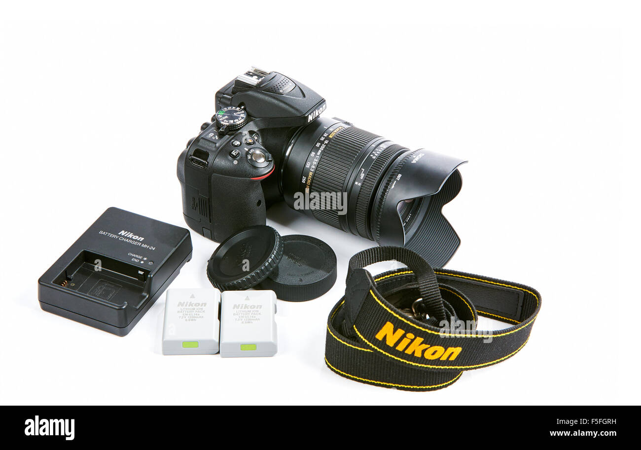 Nikon D5300 DSLR Camera with Zoom Sigma 18-250 mm OS HSM Macro Lens. Full set with batteries, charger, strap and - Stock Image