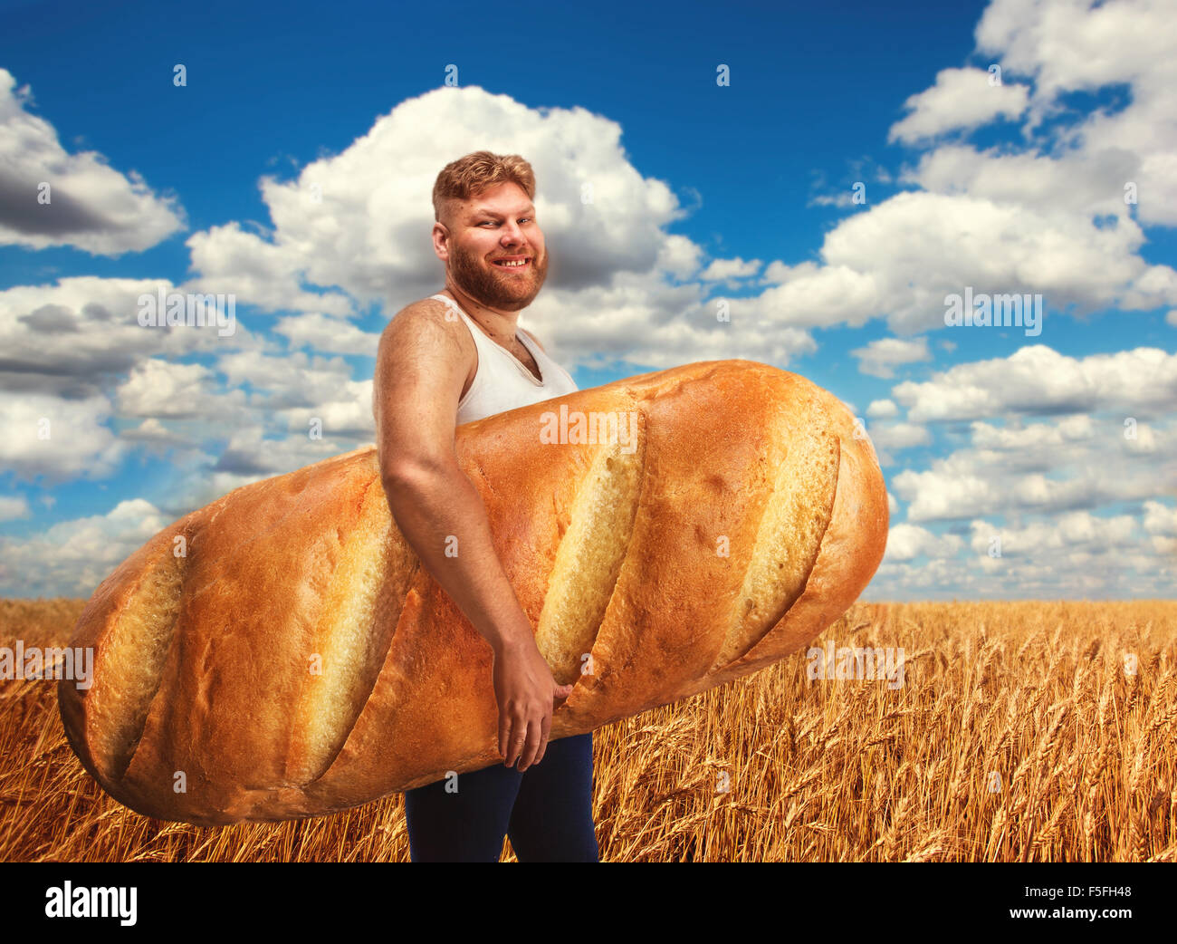 man holding a huge bread on field of wheat stock photo 89467848 alamy