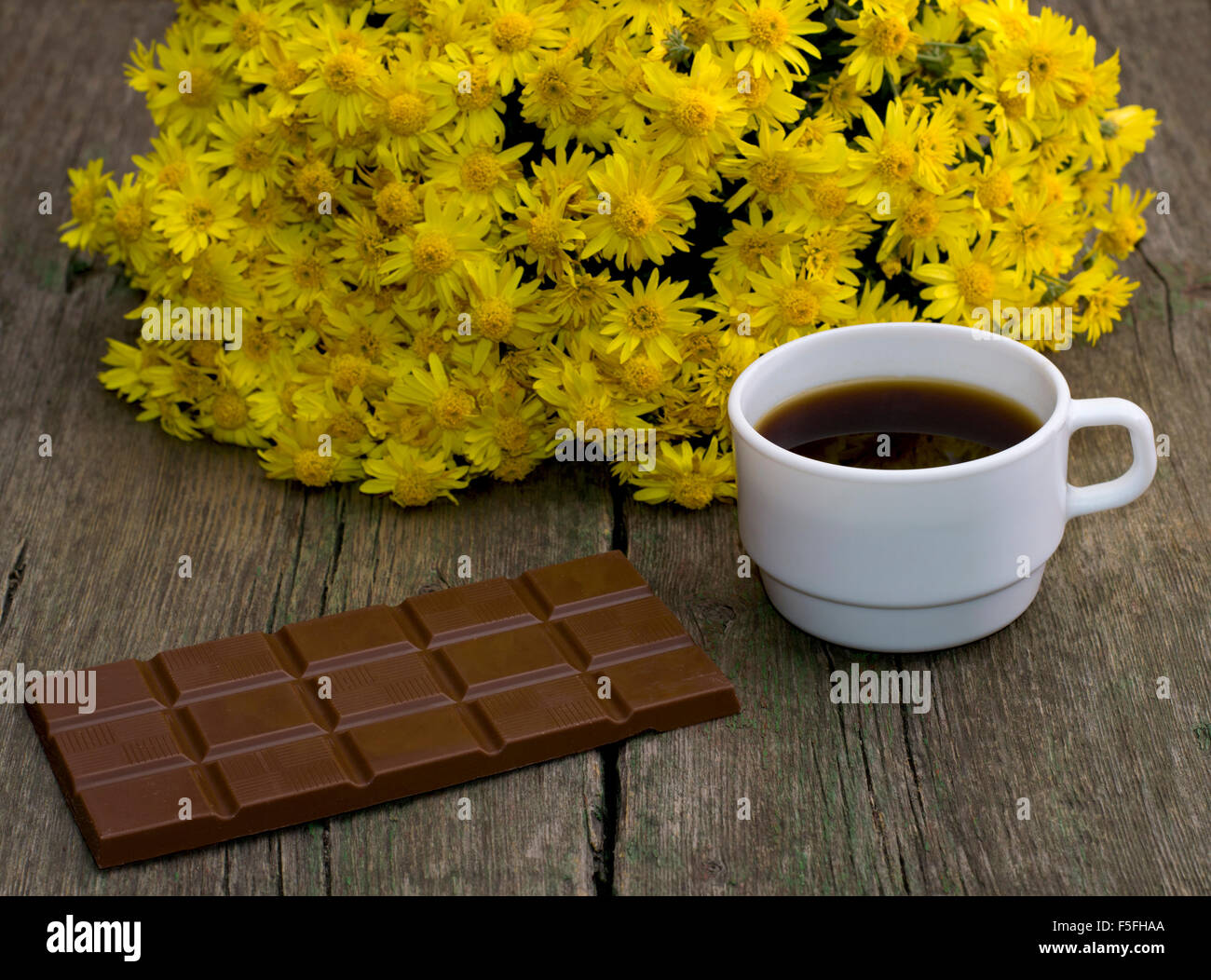 Bouquet Of Beautiful Flowers Chocolate And Coffee On A Wooden