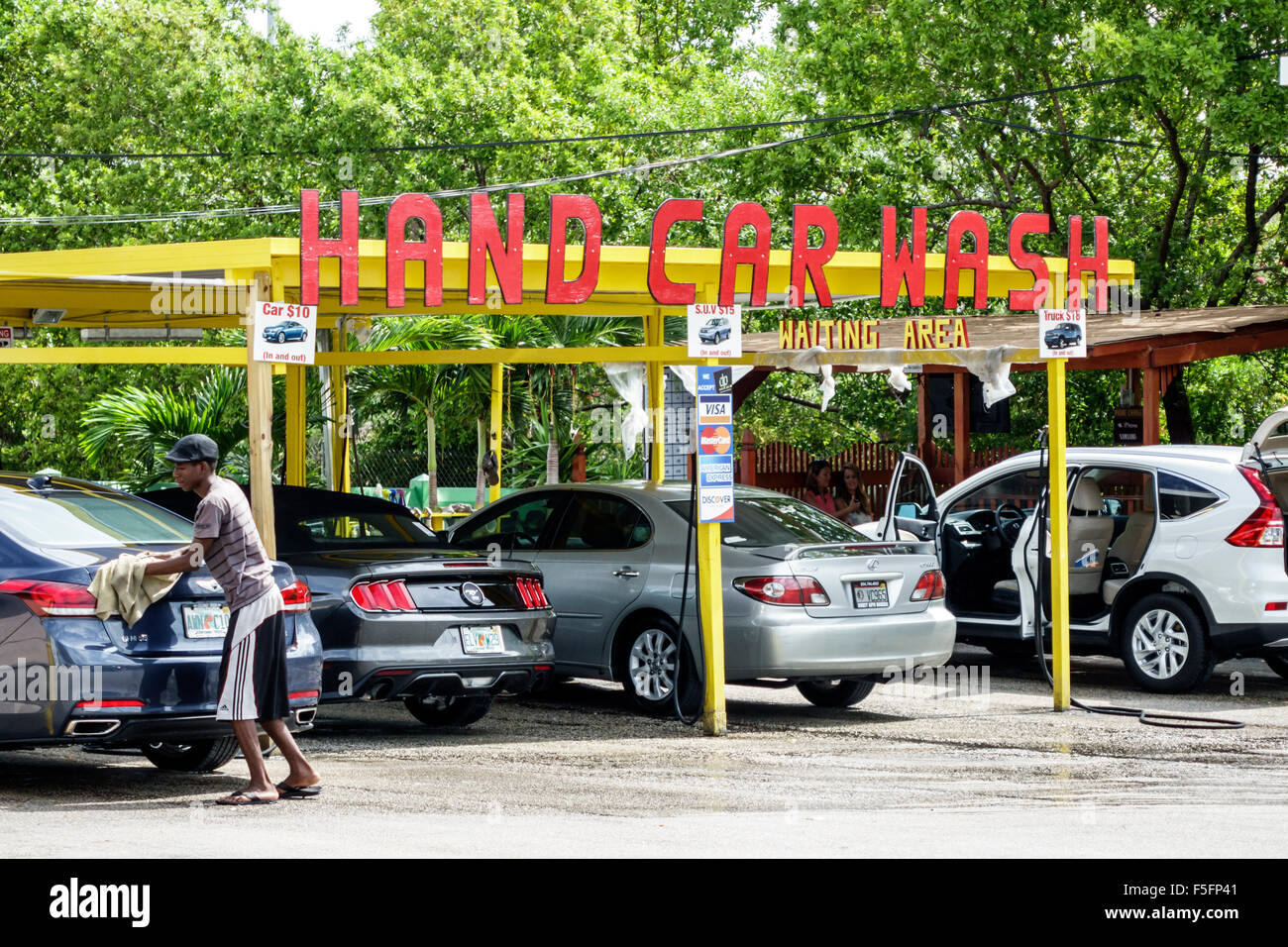 Man working car wash in stock photos man working car wash in stock fort lauderdale ft florida hand car wash black man employee job wiping cars service outside solutioingenieria Images