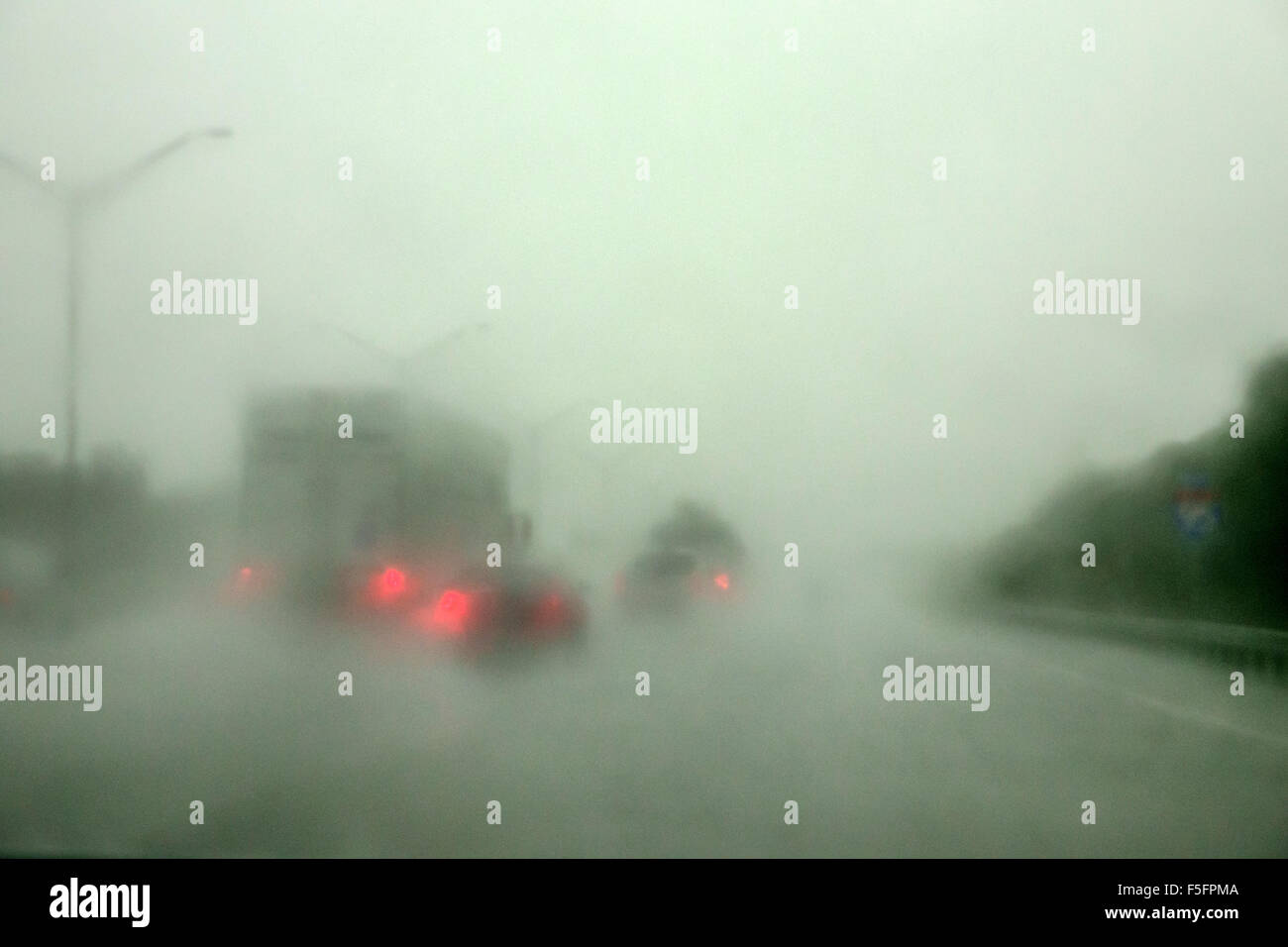 Florida Jupiter Interstate 95 I-95 view through windshield downpour heavy rainstorm traffic limited unsafe driving - Stock Image