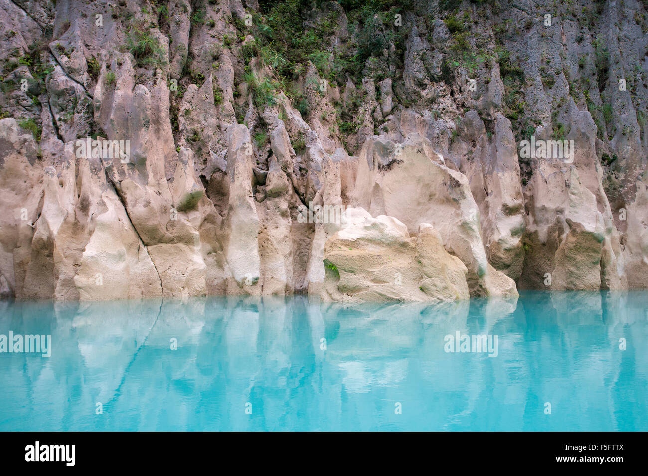 Turquoise color of the Tampaon River contrasts with rock formations in the Huasteca Potosina near Tamul Waterfalls, - Stock Image