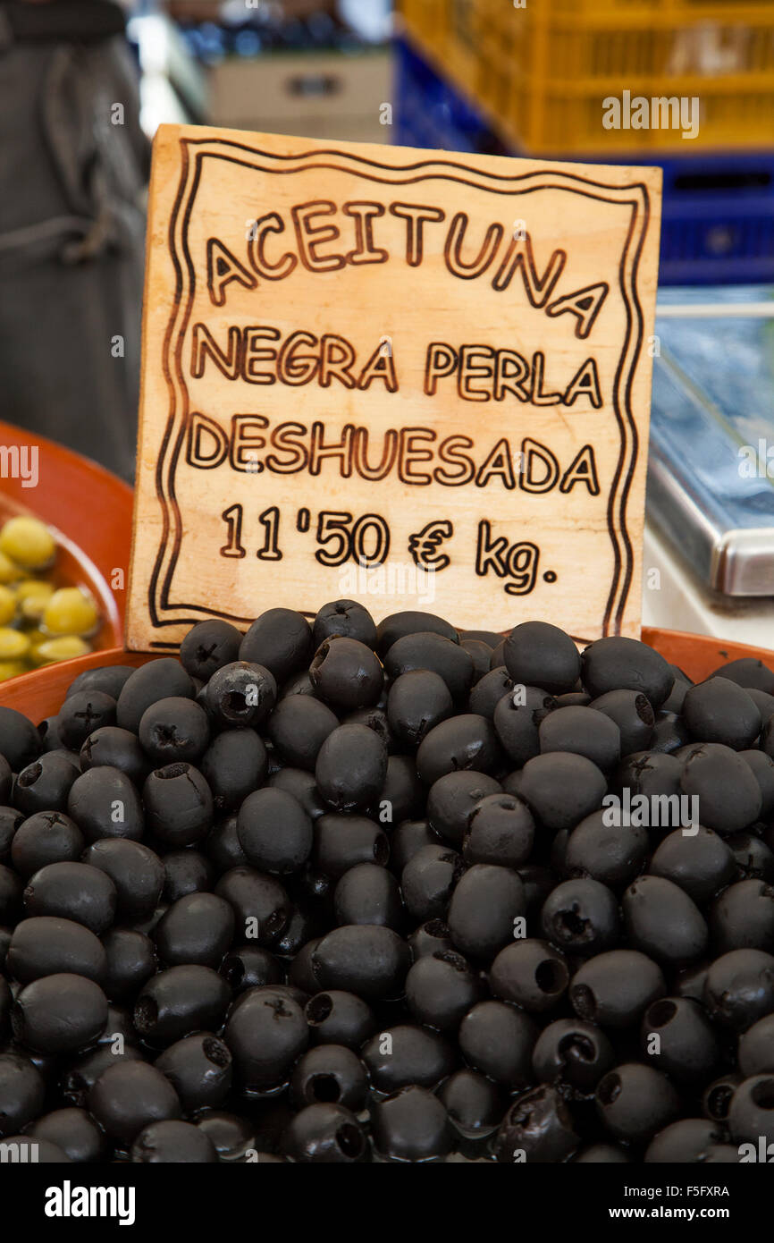 Black Olives on sale at Pollensa old town market on the island of Majorca, Spain Stock Photo