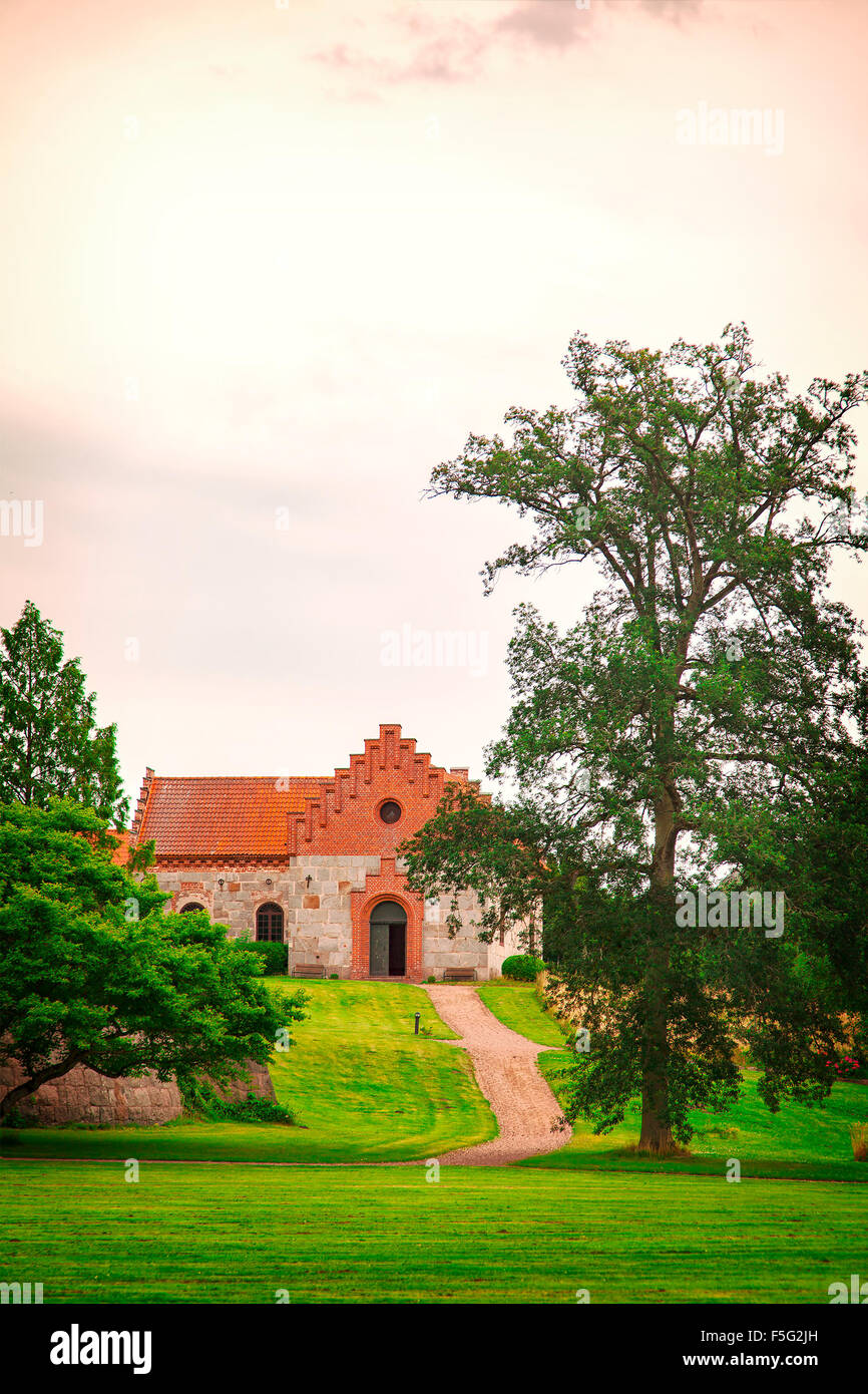 Image of the church of Nas, located on the grounds of the castle of Trollenas. Scania, Sweden. - Stock Image