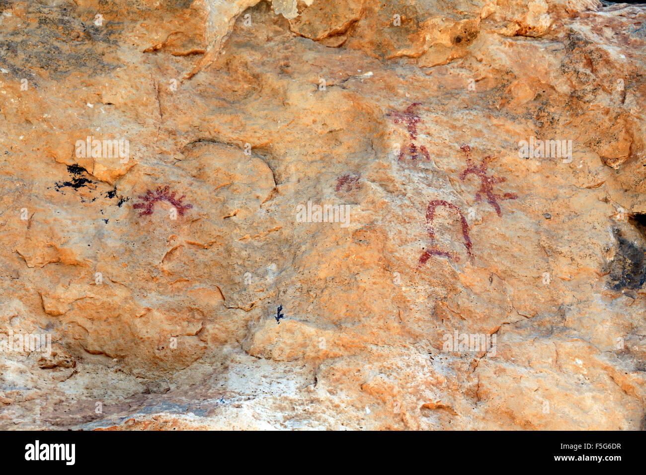 Prehistoric paintings in the cave Portell de les Lletres, near Montblanc, Tarragona, Catalonia, Spain. UNESCO World - Stock Image